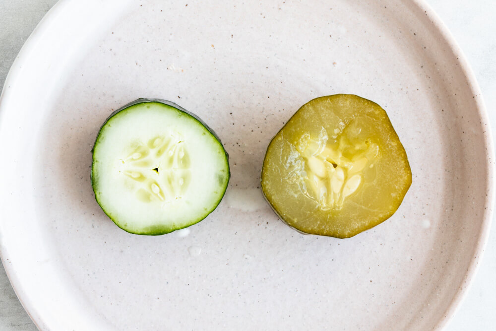 cucumber slice and pickle on a plate