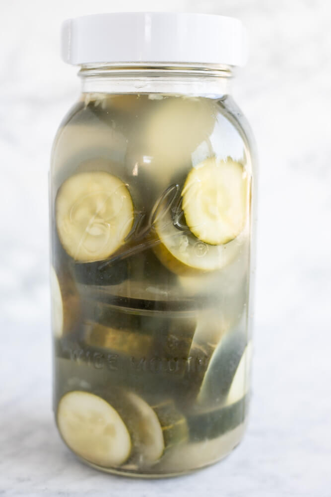 close up of a jar of homemade pickles