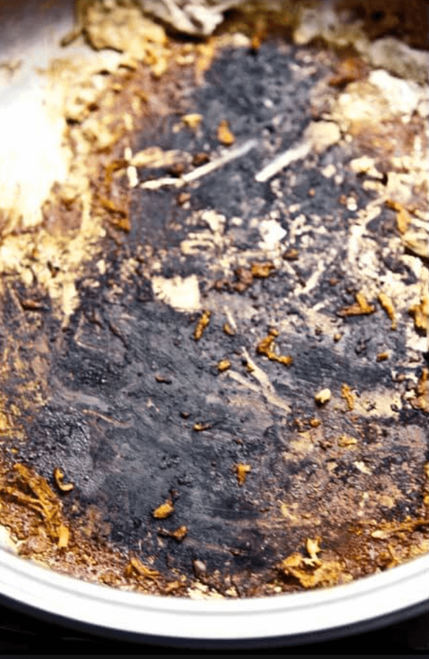 close up of burned cooing pot