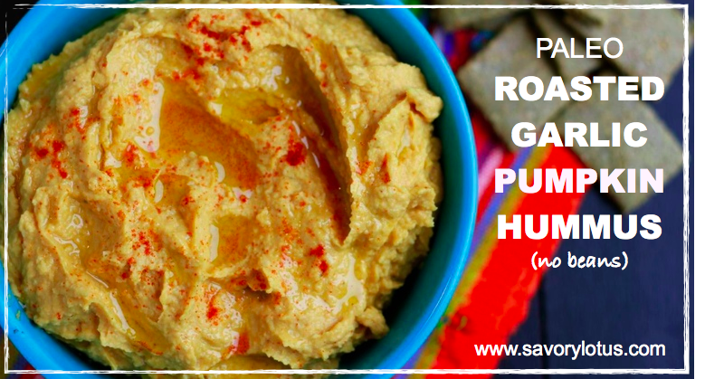 hummus in a blue bowl with paprika on top