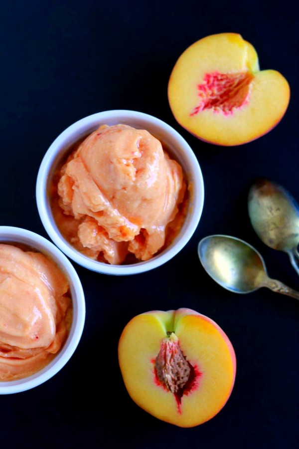peach ice cream in small white bowl