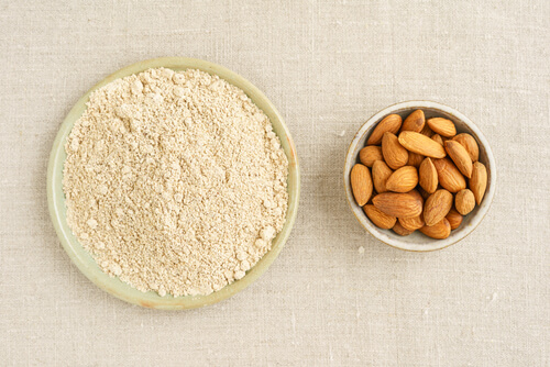 almond flour next to a bowl of almonds