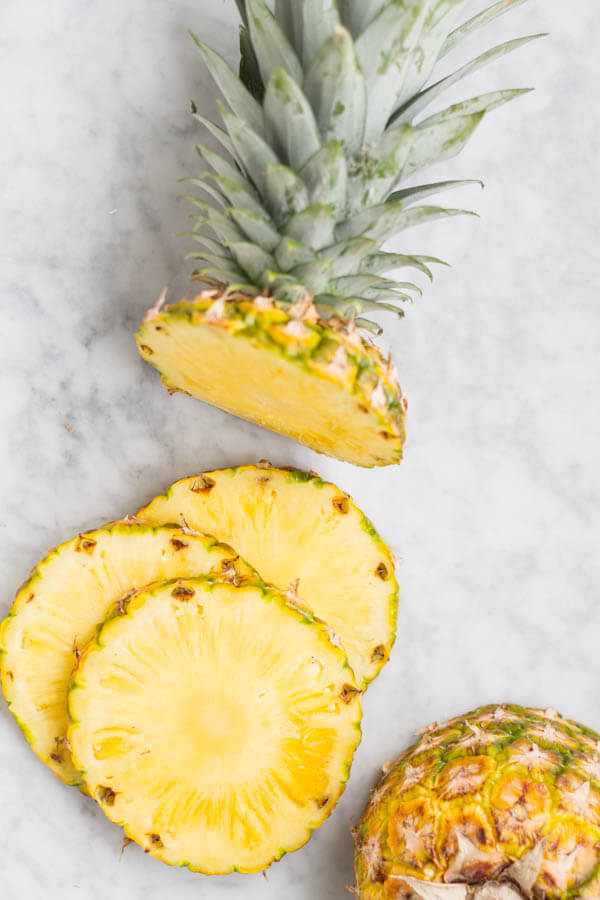 a whole pineapple in slices