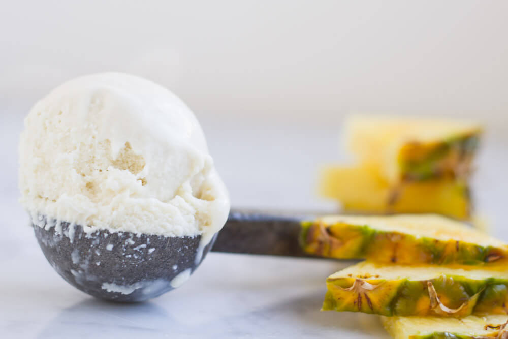 an ice cream scoop with pineapple slices