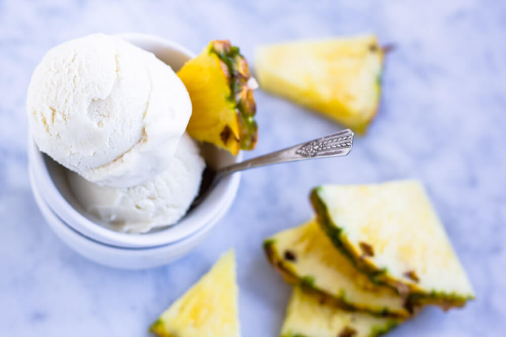 pineapple slices with white bowl of ice cream