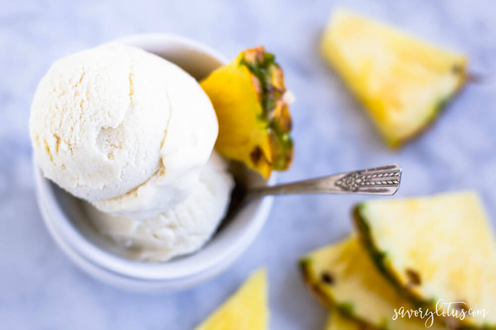 2 scoops on pineapple ice cream in white bowl