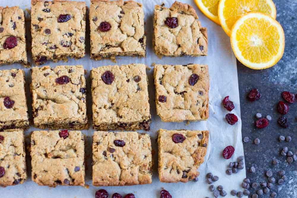 Orange Cranberry Chocolate Chip Cookie Bars cut into even squares