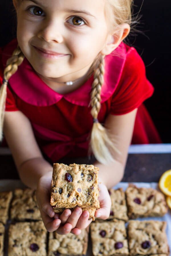 young girl holding Orange Cranberry Chocolate Chip Cookie Bars