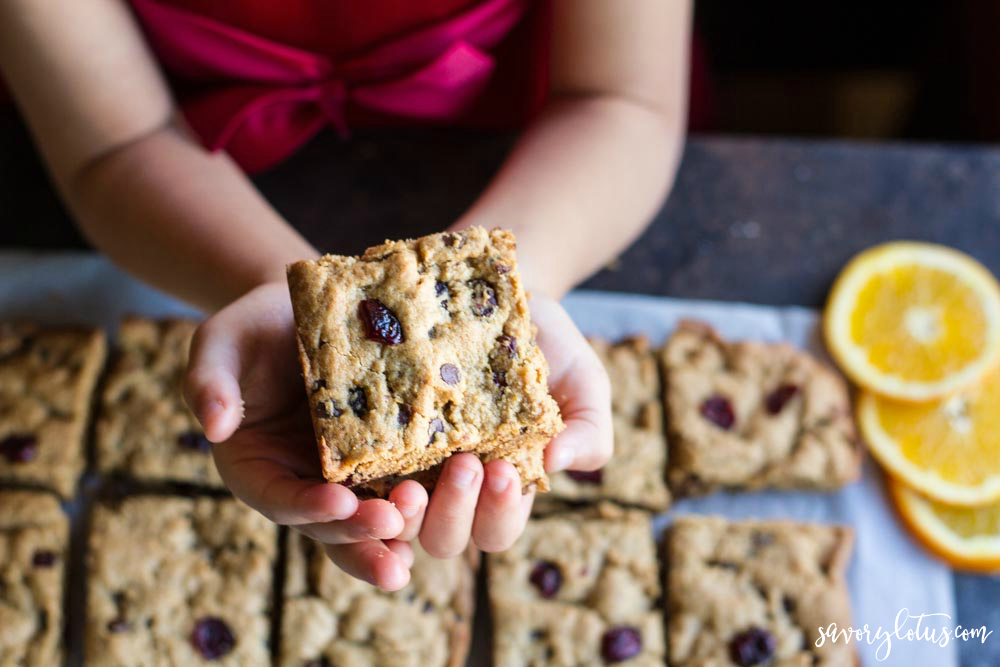 Orange Cranberry Chocolate Chip Cookie Bars held in hand