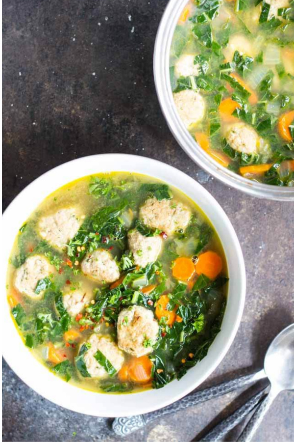 2 bowls of meatball soup in white bowls