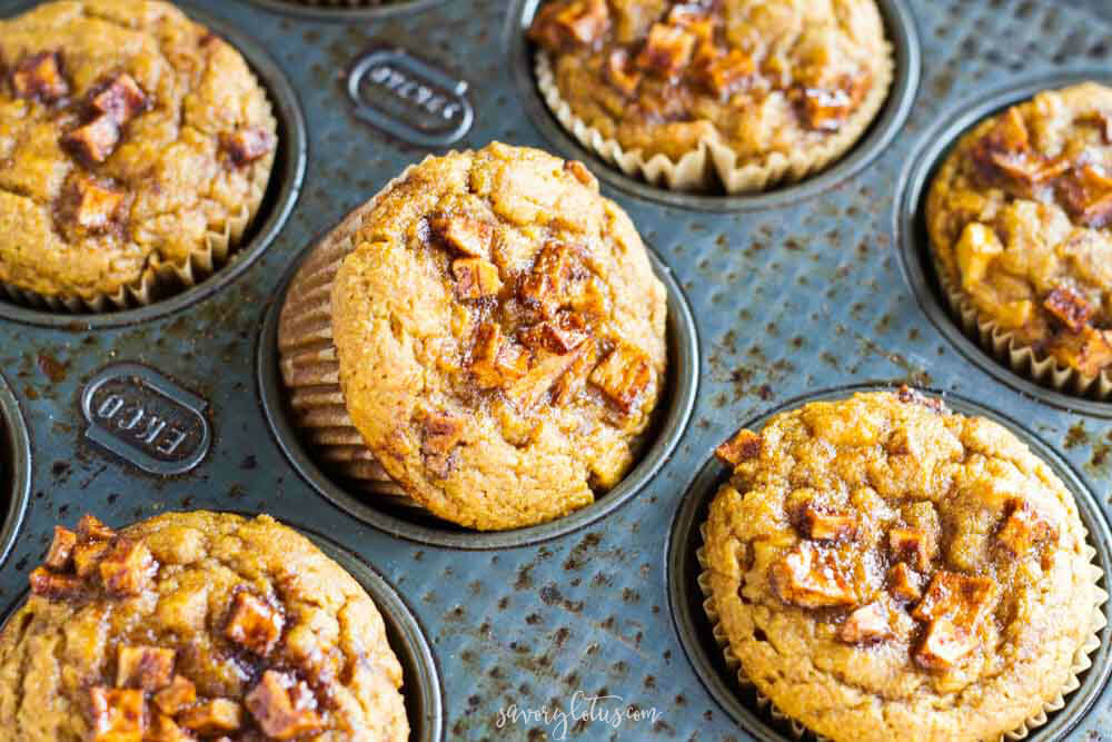 one muffin popping out of muffin tin