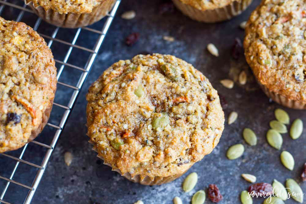 breakfast muffin sitting on counter with seeds all around