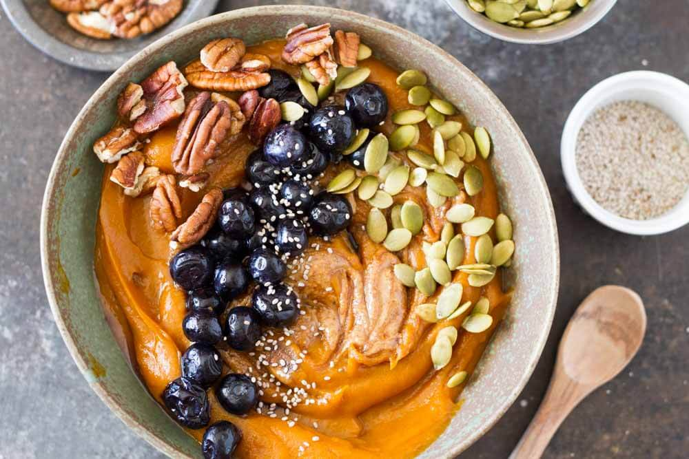 Simple Sweet Potato Breakfast Bowl (with blueberries, pecan, pumpkin seeds, chia seeds in a bowl) | www.savorylotus.com