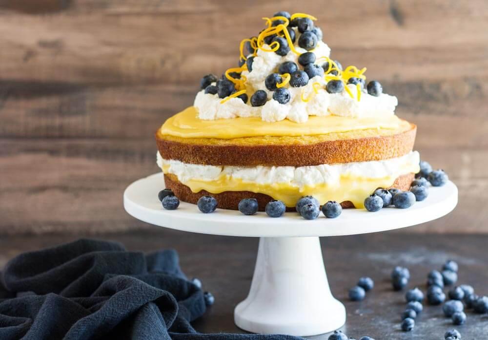 lemon curd layer cake on white cake stand