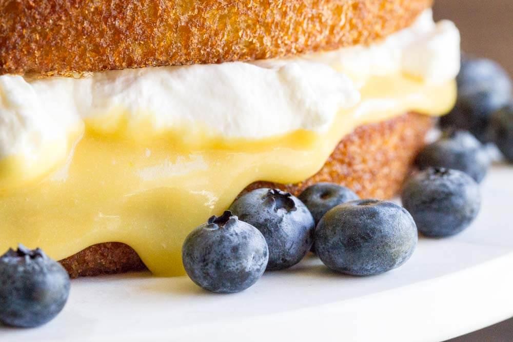 close up of lemon curd and cream cake