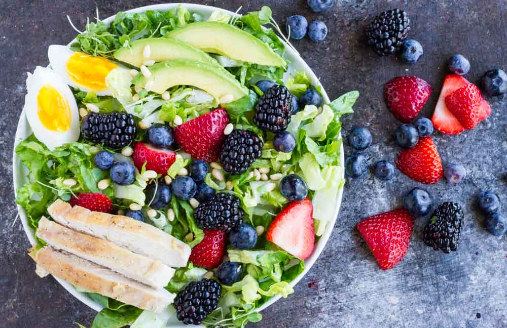 Berry Avocado Chicken Salad on white plate