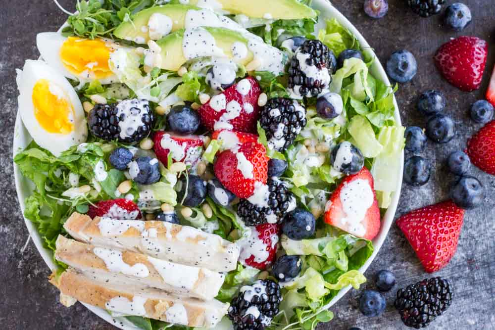 Berry Avocado Chicken Salad with white dressing on top