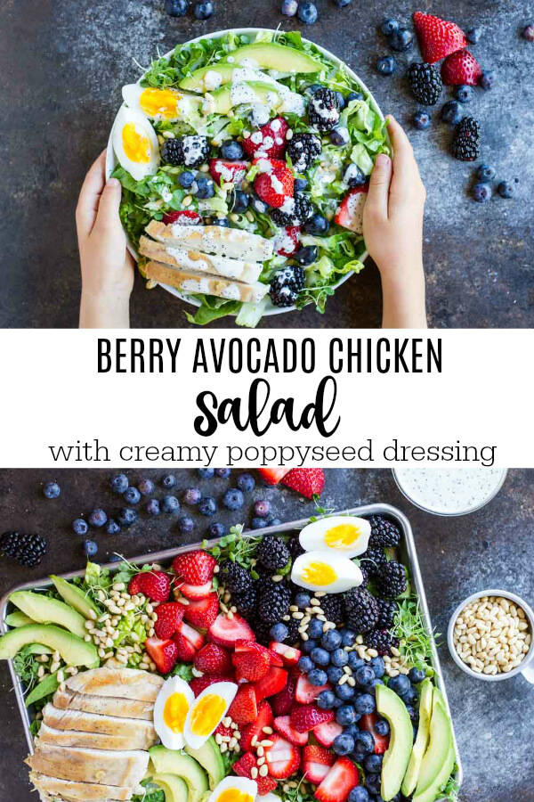 hands holding Berry Avocado Chicken Salad on white plate