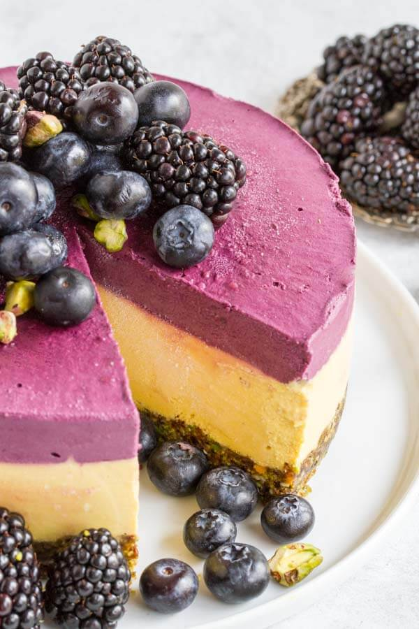 close up of Mango Blackberry Cheesecake on white plate