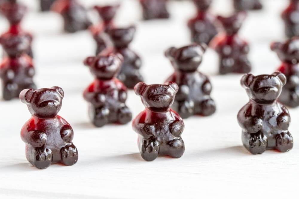 Immune Boosting Elderberry Gummy Bears on white table