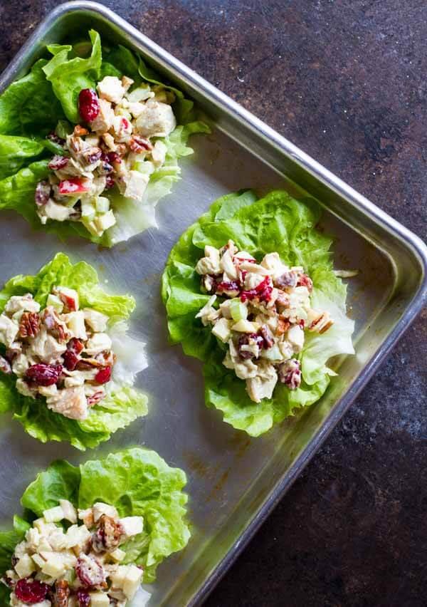 Cranberry Apple Chicken Salad on lettuce wraps on baking sheet