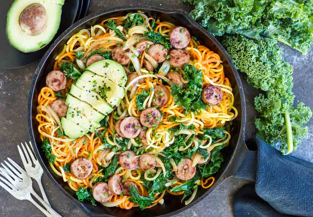 Sweet Potatoes with Sausage and Kale in cast iron skillet