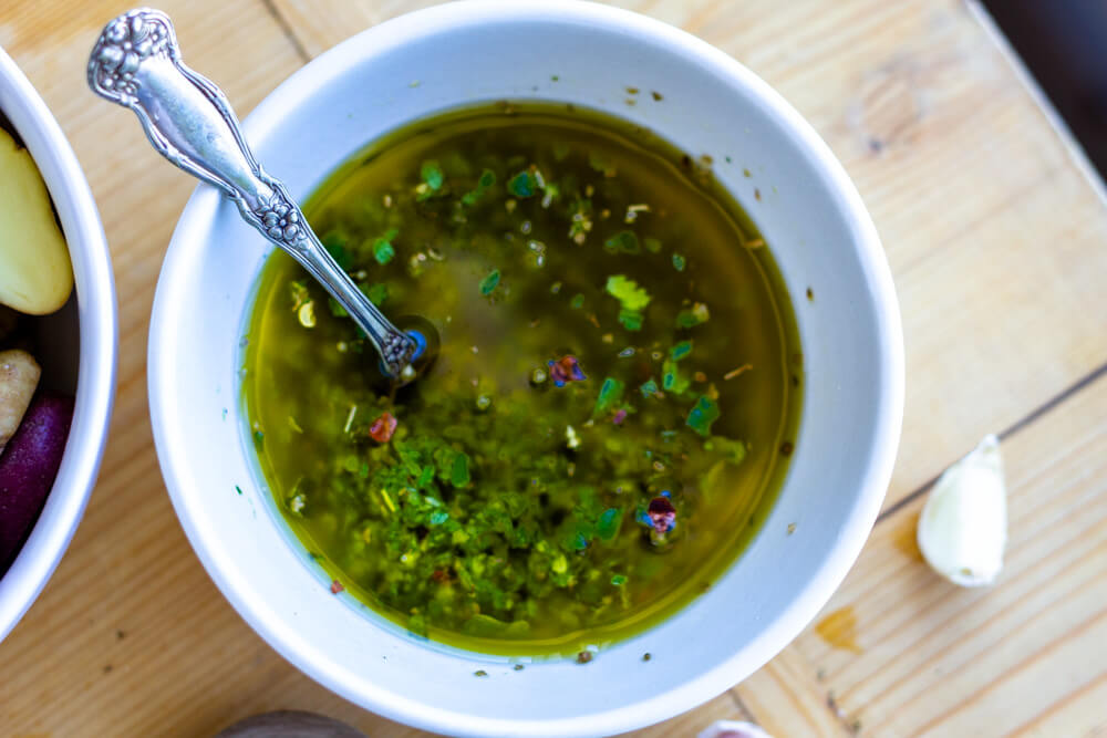 chimichurri sauce in white bowl