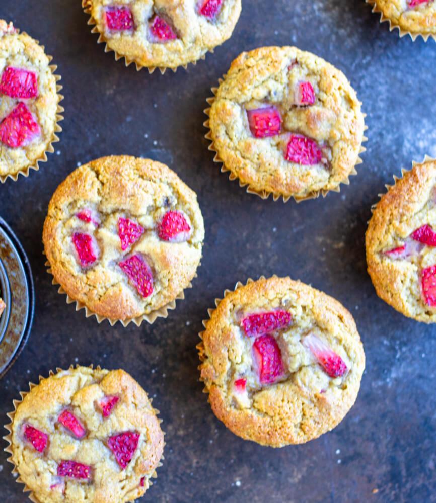 six Strawberry Banana Muffins on a baking sheet