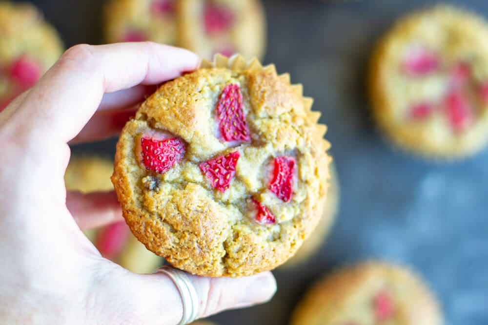 hand holding a Strawberry Banana Muffin