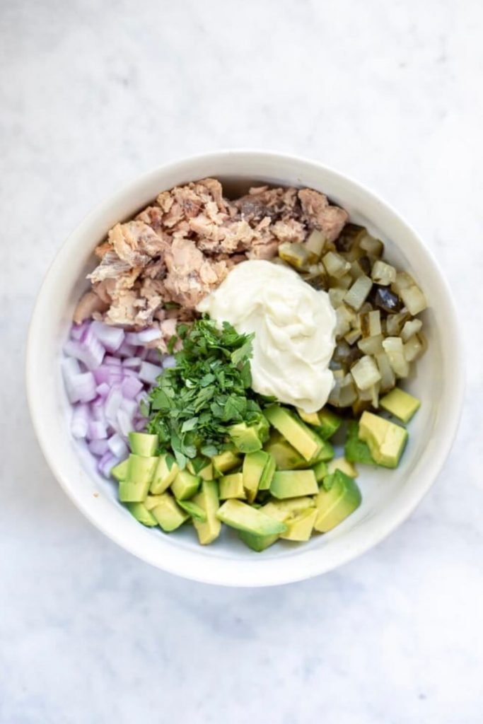 white bowl with salmon salad ingredients