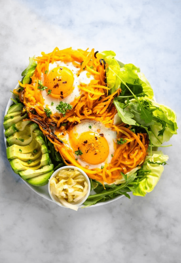 butternut squash noodle nests with fried eggs and avocado