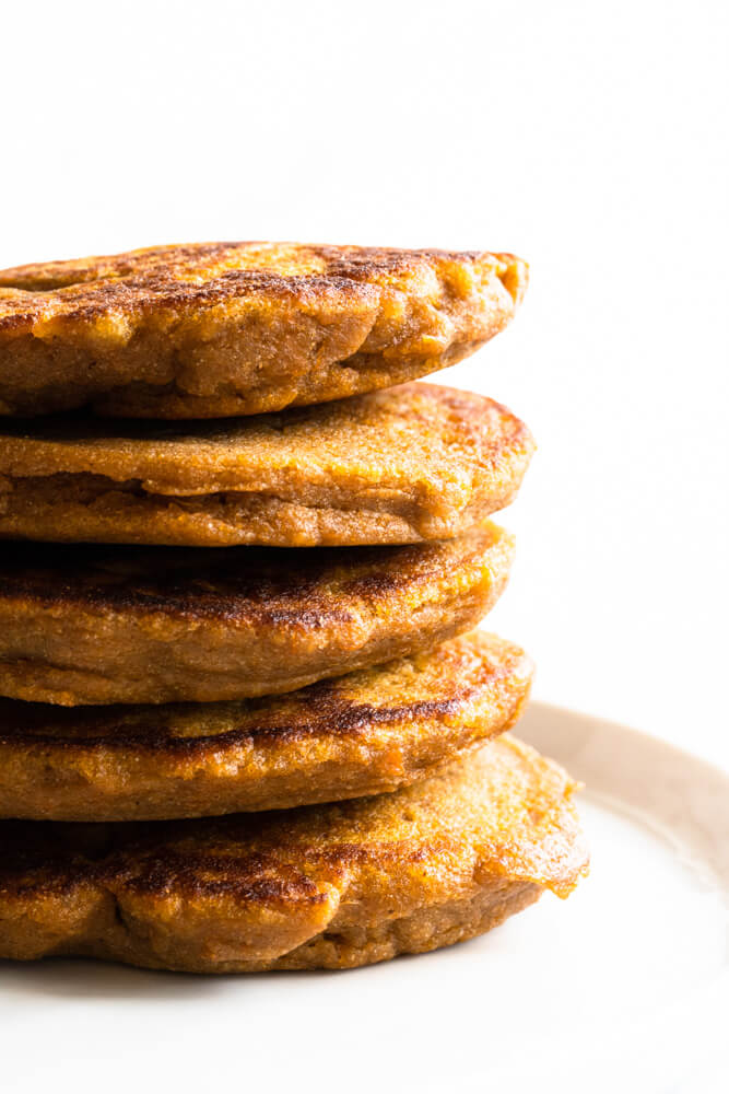 Fluffy Sweet Potato Pancakes (gluten free and paleo) -- stacked on a plate