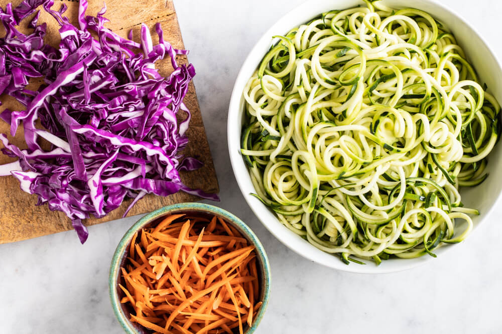 Asian Zucchini Noodles (gluten free, paleo, and whole30) - purple cabbage, zucchini noodles, and carrots