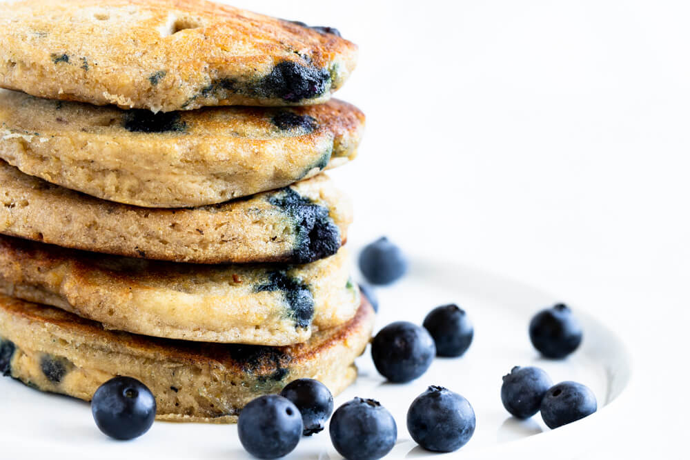 close up of a stack of blueberry pancakes