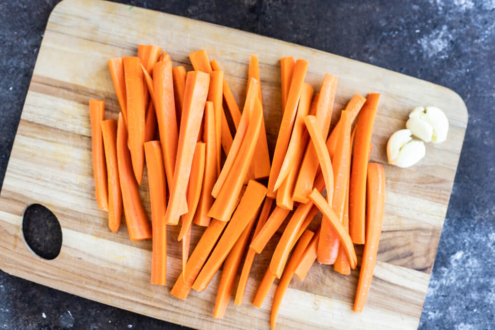 carrots sticks on a cutting board