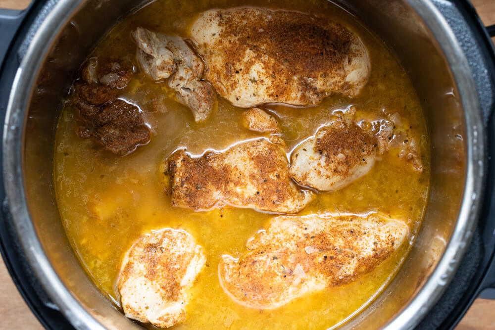 cooked chicken and spice in instant pot