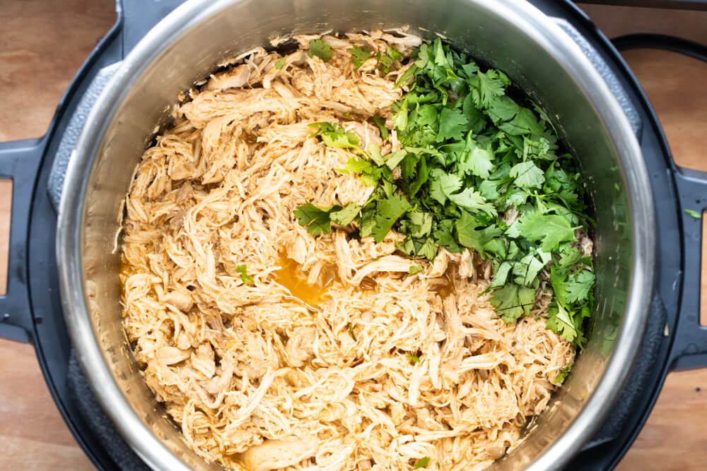 shredded chicken and cilantro in instant pot