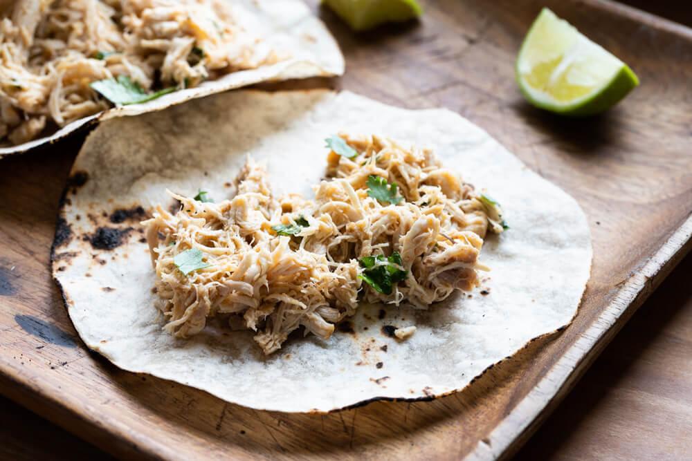 shredded chicken on a tortilla