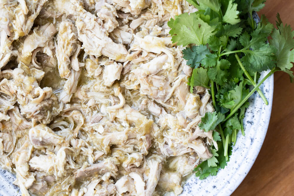 salsa verde chicken in white bowl