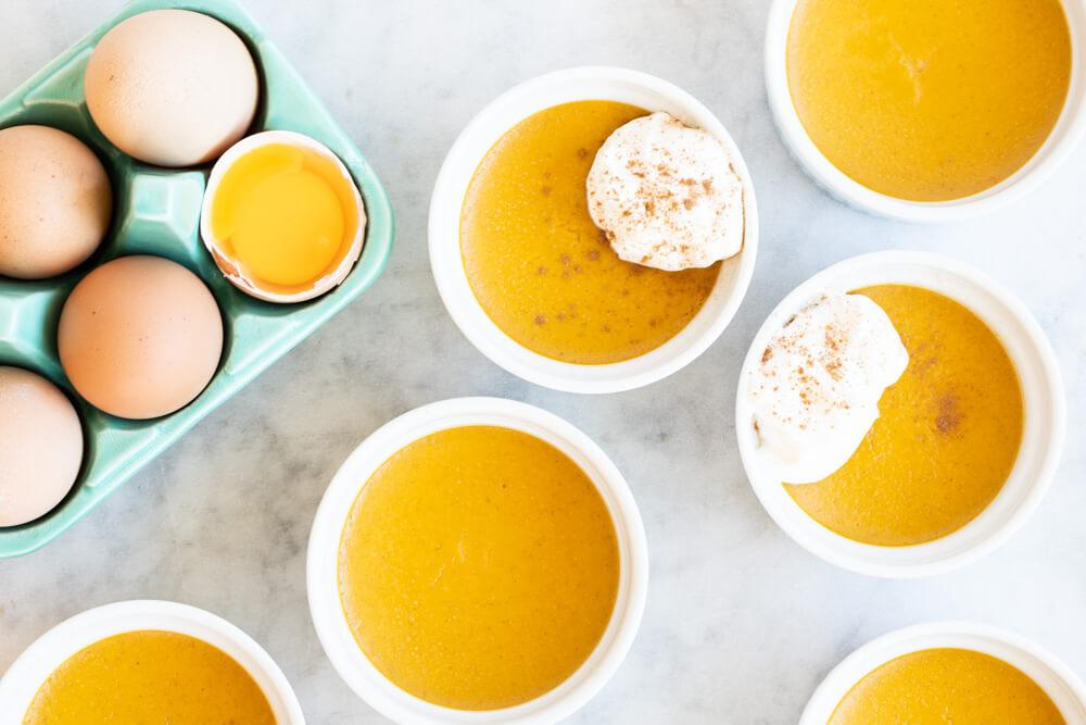 six small bowls of pumpkin custard