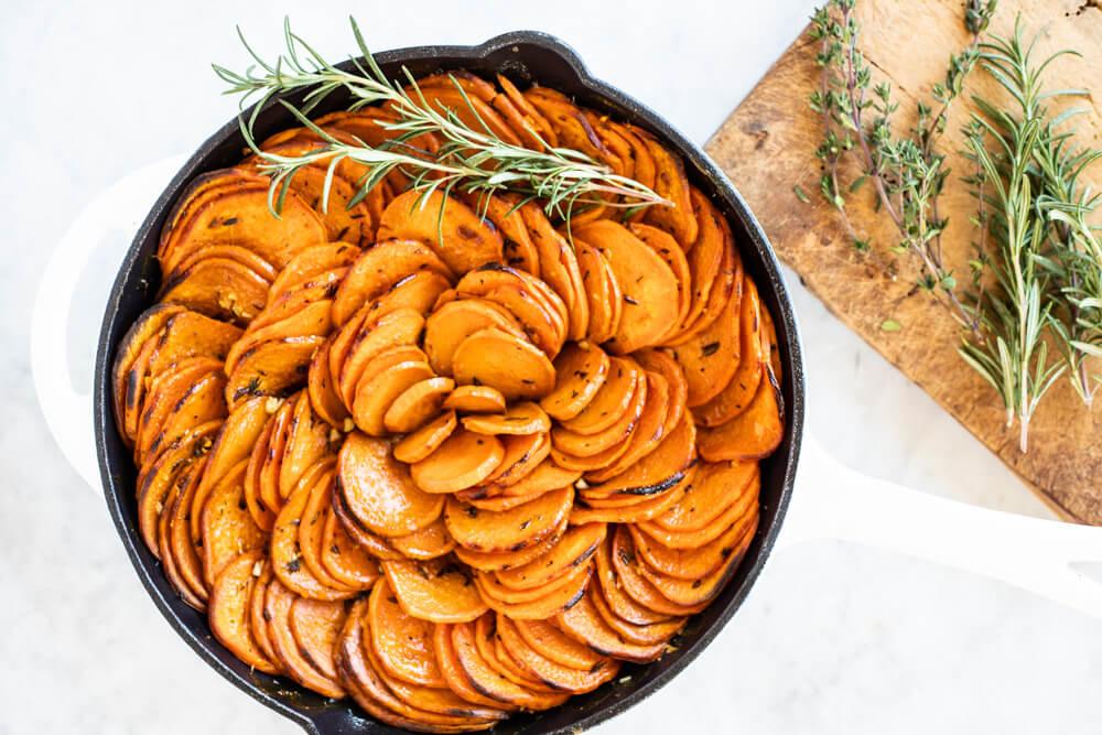 sweet potato slices in white skillet