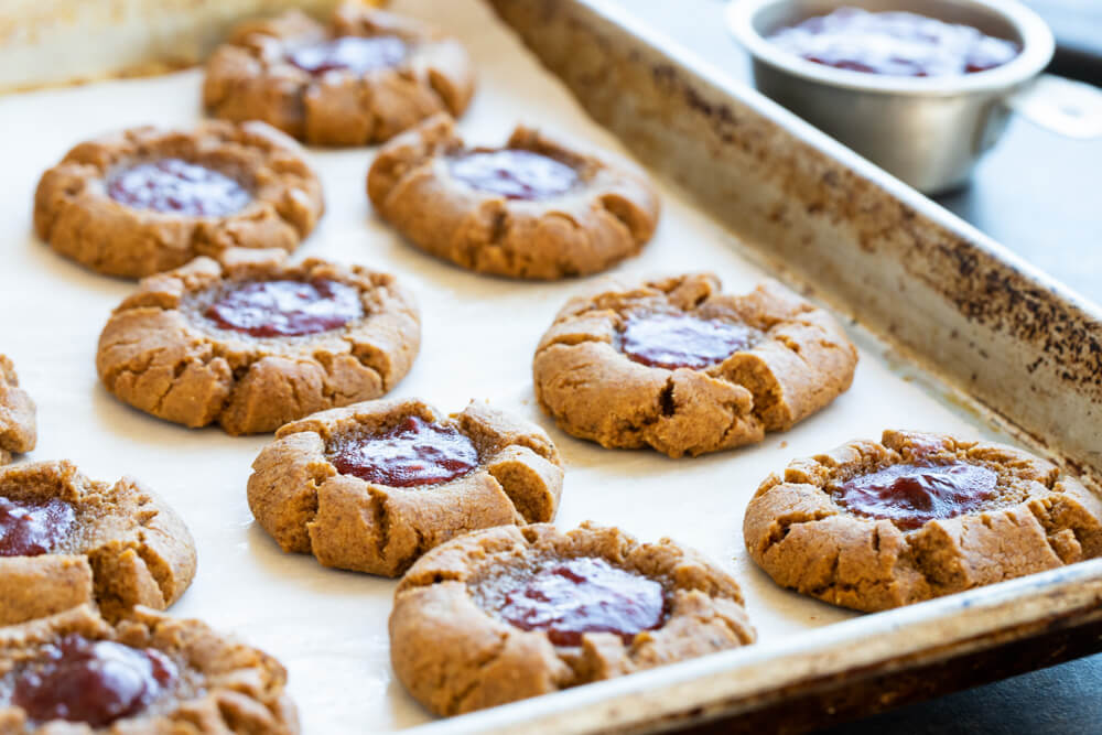 peanut butter and jelly thumbprints on cookie sheet
