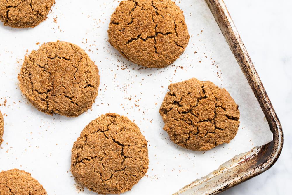 big gingerbread cookies on baking sheet